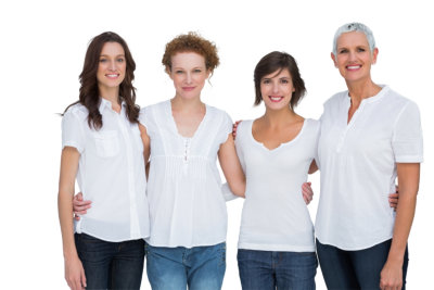 Cheerful women posing with white tops on white background