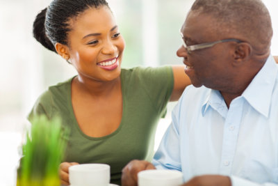 portrait of smiling caregiver and senior man