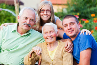 portrait of caregivers and senior couple