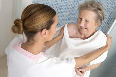 Caregiver assisting elderly women for shower